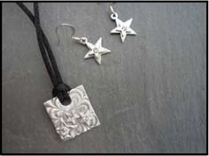 PMC Clay (precious metal clay) pendant and earrings.
