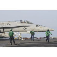 An FA-18C Hornet ready to launch from a catapult board USS Theodore Roosevelt Canvas Art - Giovanni CollaStocktrek Images (35 x 23)