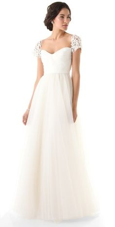 Love the tulle cap sleeves and the knot detailing