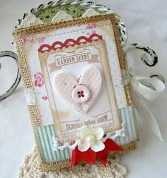 This sweet album is made with burlap, stitched and covered with beautiful papers, vintage images,embellished with lace, chipboard shapes, Vintage  - really cute downloads and handmade cards from this Etsy seller