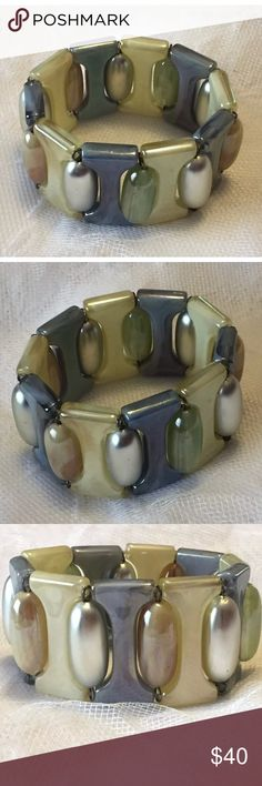 Vintage 1960's lucite bracelet made in Brazil It was my mom's.  I used to play with this bracelet.  Made in Brazil Jewelry Bracelets