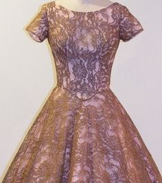 Mocha brown floral lace over a pink taffeta dress.
