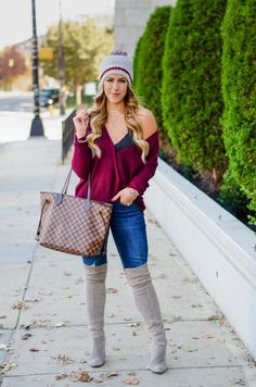 Bailey Schwartz shares a casual look including a burgundy wrap top, over the knee boots, warm beanie and her favorite Free People bralette.
