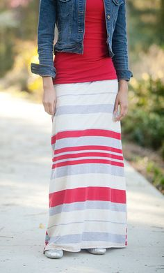 A classy touch to a classic color block maxi skirt! Dolly, is a long max skirt that has a slight aline fit for a modest feel and look and a bolt color block striped print. It is made from a combination fabric of polyester and cotton making it a strong enough fabric to go without a slip. These modest maxi skirts have a banded foldable waist, which comes in handy for adjusting the length of the skirt as they run pretty long and can even be worn as a dress if worn with a layering top.