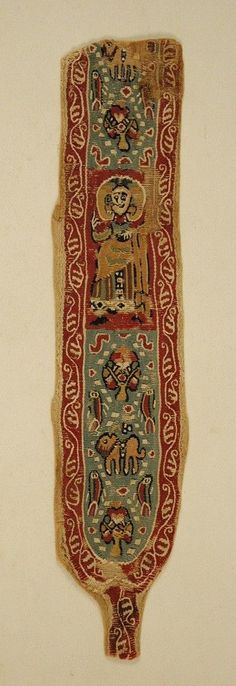 Byzantine & Christian Museum. The polychrome, woven band was part of the decoration on a chiton.  Usually a linen chiton had bands sewn in a vertical arrangement on front and back as well as towards the ends of the sleeves.