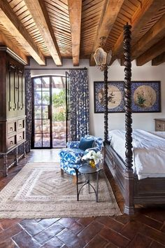 That ceiling!  Mirrored by beautiful terra cotta tiles on the floor.  Plus, I want that bed.
