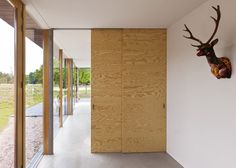 Dutch interiors studio i29 has added plywood walls, furniture and surfaces to every room inside this house in North Holland