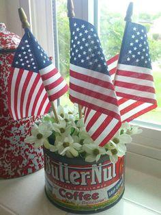 Vintage coffee can turned patriotic decor.