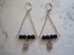 Black beaded Buddha triangle earrings. by SpotlessMindDesigns on Etsy