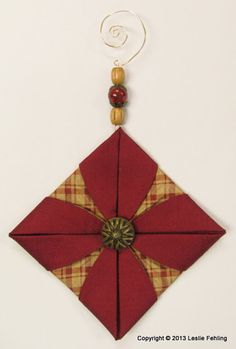 Everyday Artist: Fabric Origami - The Prettiest Ornaments On the Tree!  make the ornament hangers by twisting 20 gauge wire into spirals, squares, and hearts, adding beads and buttons to coordinate with the fabric colors.