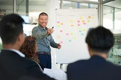 Shot of a man giving a presentation to colleagues in an office - stock photo #1361881