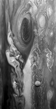Europa hanging over the great red spot of Jupiter