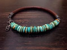 Mens bracelet, single wrap adjustable, This native inspired wrap features Heishi genuine Turquoise and a soft natural round antique Brown leather. This distinctive bracelet wraps around the wrist twice and includes a lobster clasp and an extension hammered sterling silver chain for a
