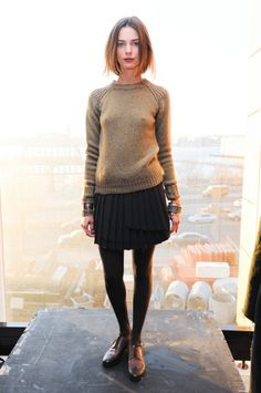 black tights with short black pleated skirt, oxfords, simple sweater with shoulder detail