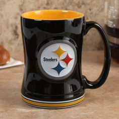 Pittsburgh Steelers 15 Ounce Sculpted Logo Relief Coffee Mug by Boelter. $13.92. For the truly devoted fan, we are proud to present this officially licensed Pittsburgh Steelers coffee mug from Boelter Brands. Now you can brighten up your office or home with your favorite NFL team's colors and logo while you enjoy your favorite beverage. The 15-ounce ceramic mug features a 3-D sculpted relief logo on each side, plus the team name printed on the handle. Perfect for coffee, ...