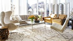AN AIRY MANHATTAN APARTMENT, DESIGNED TO SELL Designer Neal Beckstedt brings life to an empty spec apartment with gorgeous furniture and uni...