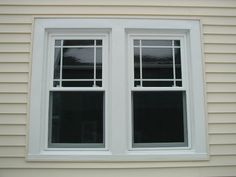 Prairie grid style vinyl replacement windows.