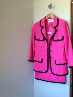 Chanel vintage classic pink wool boucle black trim skirt suit. French size 36. Final Sale.    http://inside.chanel.com/en/#!/jacket