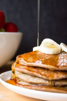 Skinny Banana Pancakes that are gluten free, dairy free, have no refined sugars & taste completely delicious! Give this easy recipe a try