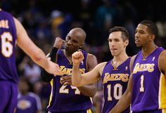 Kobe's face...Priceless! - Kobe Bryant, Pau Gasol, Steve Nash, and Darius Morris #1 of the Los Angeles Lakers celebrate their OT win against the Golden State Warriors. (December 22, 2012 | Oracle Arena in Oakland, California)