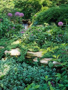 ideen gartenmauer aus naturstein viel grüne