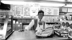 Co-owner Dennis Lowman @ Rookie's Market in Annapolis, MD... (It was the last grocery store in downtown Annapolis... Rookie's closed March 12, 1989 after more than 45 years in business)... Note the sign behind Lowman says cold cut subs are $2...