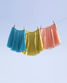 Candy-colored pleated skirts