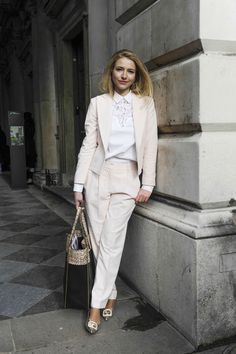 so chic and sophisticated. beige suite combined with a white blouse.