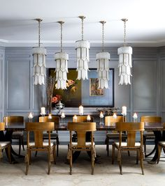 : Eye Catching Hanging Chandelier In White Arranged Along The Long Table Set With Wooden Chairs And Centerpiece