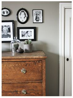 Black frames, grey wall. Love the mix of modern and rustic