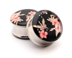 Vintage Floral Picture Plugs Style 5 gauges - 2g, 0g, 00g, 7/16, 1/2, 9/16, 5/8, 3/4, 7/8, 1 inch. $19.99, via Etsy.