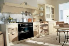 Costum Country Kitchen Cabinets With Chrome Hanging Racks And Black Dining Table Legs