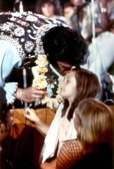 Elvis kisses a young fan...how sweet!