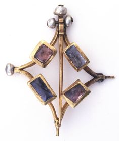 Annular brooch; gold; openwork; lozenge-shaped; set with pearls, sapphires and purple-pink spinels en cabochon.