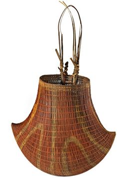 Bicornial basket of woven cane, from Queensland, early 1900s. Baskets with this distinctive crescent shape are made by men and women in northern Queensland, and can be used for fishing as well as carrying.