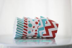 Red and Aqua Cupcake Wrappers Set of 12 by ooohlalapaperie on Etsy, $5.00  These cupcake wrappers are the right touch for a zoo or circus/carnival, Dr. Seuss-theme, even for a patriotic party.
