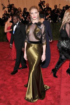 Met Gala: Who Wore What: Blake Lively was every bit the movie star in her Gucci Première pale green strapless gown with silver and matte black feather embroideries, finished with Lorraine Schwartz jewels.: Rosie Huntington-Whiteley exposed just enough skin in her Gucci black-and-gold gown netted gown.