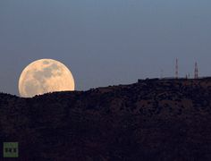 The full moon rises from the top of the Haramoun mountain, as seen from Marjayoun village in south Lebanon, May 5, 2012