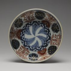 Circular bowl of porcelain decorated in underglaze blue and overglaze enamels with foliage designs: Japan, 18th-19th century,  K.2005.629