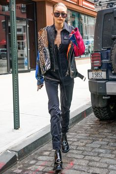 Gigi Hadid was spotted in New York wearing a grey boiler suit and patent ankle-boots.