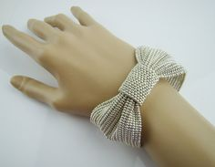 Hey, I found this really awesome Etsy listing at https://www.etsy.com/listing/173970786/silver-bow-cuff-bracelet-seed-beads
