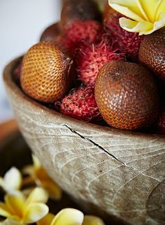 Bali traditions are often in the delicious details, such as this wooden bowl overflowing with snake fruit and rambutan.