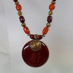 #Vintage Boho Large Brown Amber Medallion Necklace. Chunky Tribal Amber Brown Brass Pendant Necklace.  This vintage Boho large brown amber medallion necklace is gorgeous.  It features various sizes and shapes of dark brown and amber brown transluscent beads alternating with ... #etsy #antique #jewelry #jewellery #prom #shopping #gifts #spring