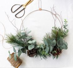 Faux pine and eucalyptus wreath with pine cones and branches on a diameter silver steel ring thick). Leather strap with a silver chain for hanging. Reminiscent of modern Swedish cottage and minimalist Scandinavian decor. Minimal Christmas, Natural Christmas, Modern Christmas, Simple Christmas, Modern Holiday Decor, Scandinavian Christmas Decorations, Diy Fall Wreath, Holiday Wreaths, Christmas Ring