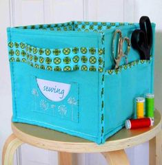 "Hemma Design Marta Studio Bin Pattern -  What: Construct storage bins from canvas, twill, or linen, and add decorative flair with an embroidered pocket.    Why: Measuring 9-1/2x9-1/2x8-1/2"", the finished bins are the perfect size for storing folded fabric, precuts, or patterns. Price: $12.95 For more info: hemmadesign.com"