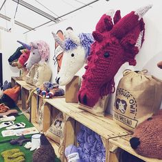 We are here and set up! Hello @handmadefair! Come meet my latest critter 🐲🐲🐲 he just needs a name, any suggestions @coralblueweddingsandevents? Oh and yes there are s few unicorn kits here! Get them whilst you can 🦄🦄🦄 #knitting #sincerelylouise #fauxtaxidermyknits #diy #makeyourown #unicorn #dragon #etsy #fauxtaxidermy #wool #craft #yarn
