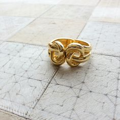 Gold knot cuff by Kenneth Jay Lane. Available at www.pinwheeljewels.com