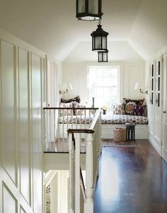 Love the contrast between white walls, and dark pendants and floors.  Love the upstairs reading area.