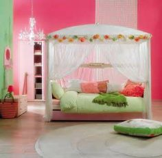 This is a room that any little girl would love. Pink walls and a beautiful twin bed. Simple and pretty.