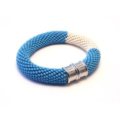 Blue and White Bracelet (€24) via Polyvore featuring jewelry, bracelets, bracelets bangle, statement bracelet, bead crochet jewelry, hinged bangles and chunky jewellery